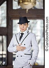 Confident Tango Dancer Performing At Restaurant