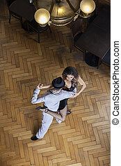 Confident Tango Dancers Performing On Hardwood Floor