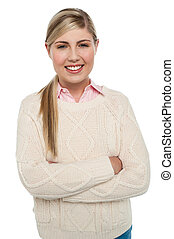 Confident teenage girl posing with folded arms