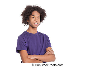 Confident teenager. Smiling African teenage boy keeping arms...