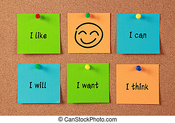 Confident Thinking sticky notes pinned on cork.
