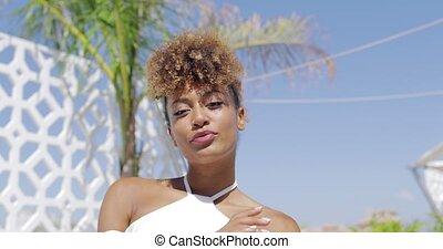 Confident trendy model in sunlight - Portrait of ethnic...