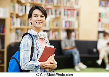 Confident university student in library