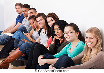 Confident University Students Sitting In A Row