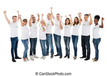 Confident Volunteers With Arms Raised Standing In Row - Full...