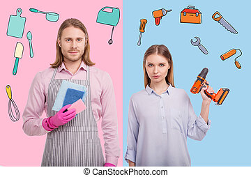 Confident woman holding a drill while her husband standing with washups