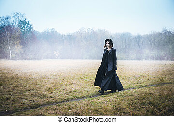 Confident woman in a black coat