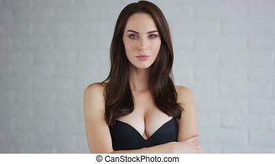 Confident woman in black bra - Attractive young female in...