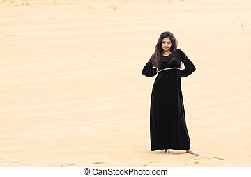 Confident woman in desert