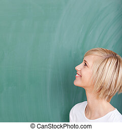 confident woman looking up on chalkboard