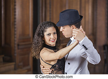 Confident Woman Performing Tango With Male Dancer