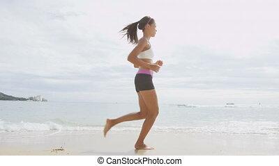 Confident Woman Running On Sea Shore
