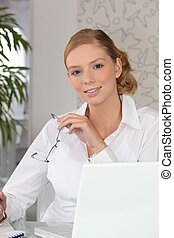 Confident woman sitting at a desk