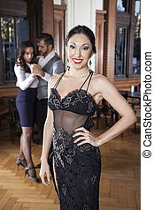 Confident Woman Smiling While Dancers Doing Tango