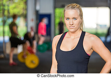 Confident Woman Standing in Gym