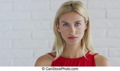 Confident woman with blue eyes - Attractive young female...