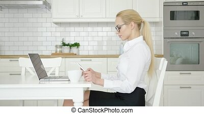 Confident woman working at home - Side view of young...