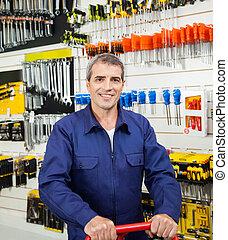 Confident Worker In Hardware Shop