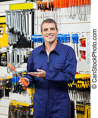 Confident Worker Showing Packed Screwdriver