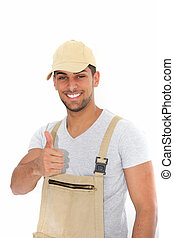 Confident workman giving a thumbs up