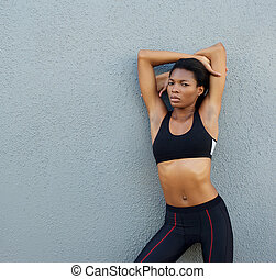 Confident young black fitness woman