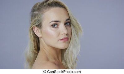 Confident young blonde model - Portrait of young confident...