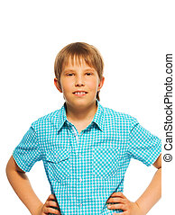 Confident young boy in blue shirt