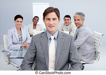 Confident young businessman in a meeting