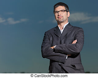 confident young businessman looking at the camera