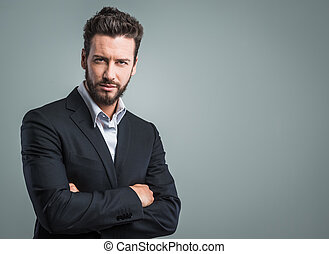 Confident young businessman posing