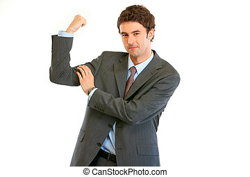 Confident young  businessman showing his  muscles isolated on white