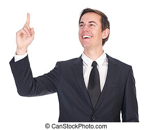 Confident young businessman smiling and pointing finger