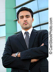 Confident young businessman stood outside office