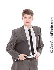 confident young businessman with a laptop .isolated on a white