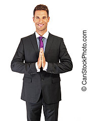 Confident young businessman with his hands clasped