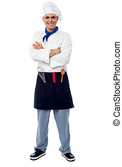 Confident young cook posing in uniform