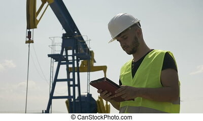 Confident young engineer analyzing schedule for oil activity...
