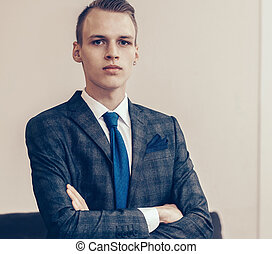 confident young entrepreneur standing in the office