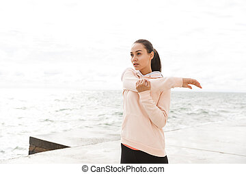 Confident young fitness asian woman exercising