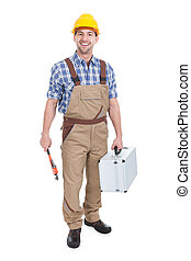Confident Young Male Worker With Wrench And Toolbox