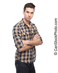 Confident young man posing with arms crossed