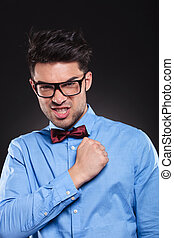 Confident young man staring at camera with his fist clenched