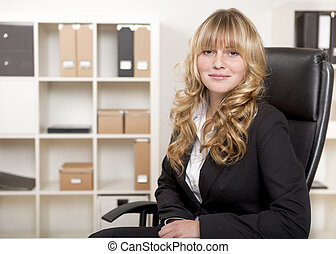 Confident young manageress in her office