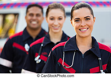paramedic team - confident young paramedic team in front of...