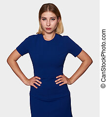 Confident young pretty woman in blue dress. Isolated