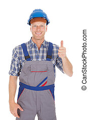 Confident Young Repairman Gesturing Thumbs Up