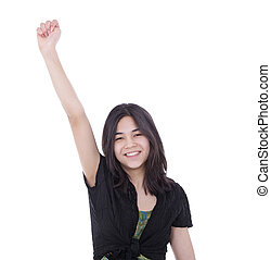Confident young teen girl with one arm raised in success - ...