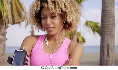 Confident young woman listening to music