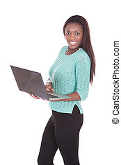 Confident young woman using laptop over white background