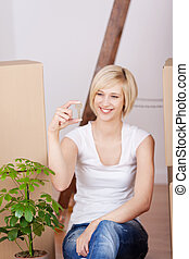 confident young woman with house key